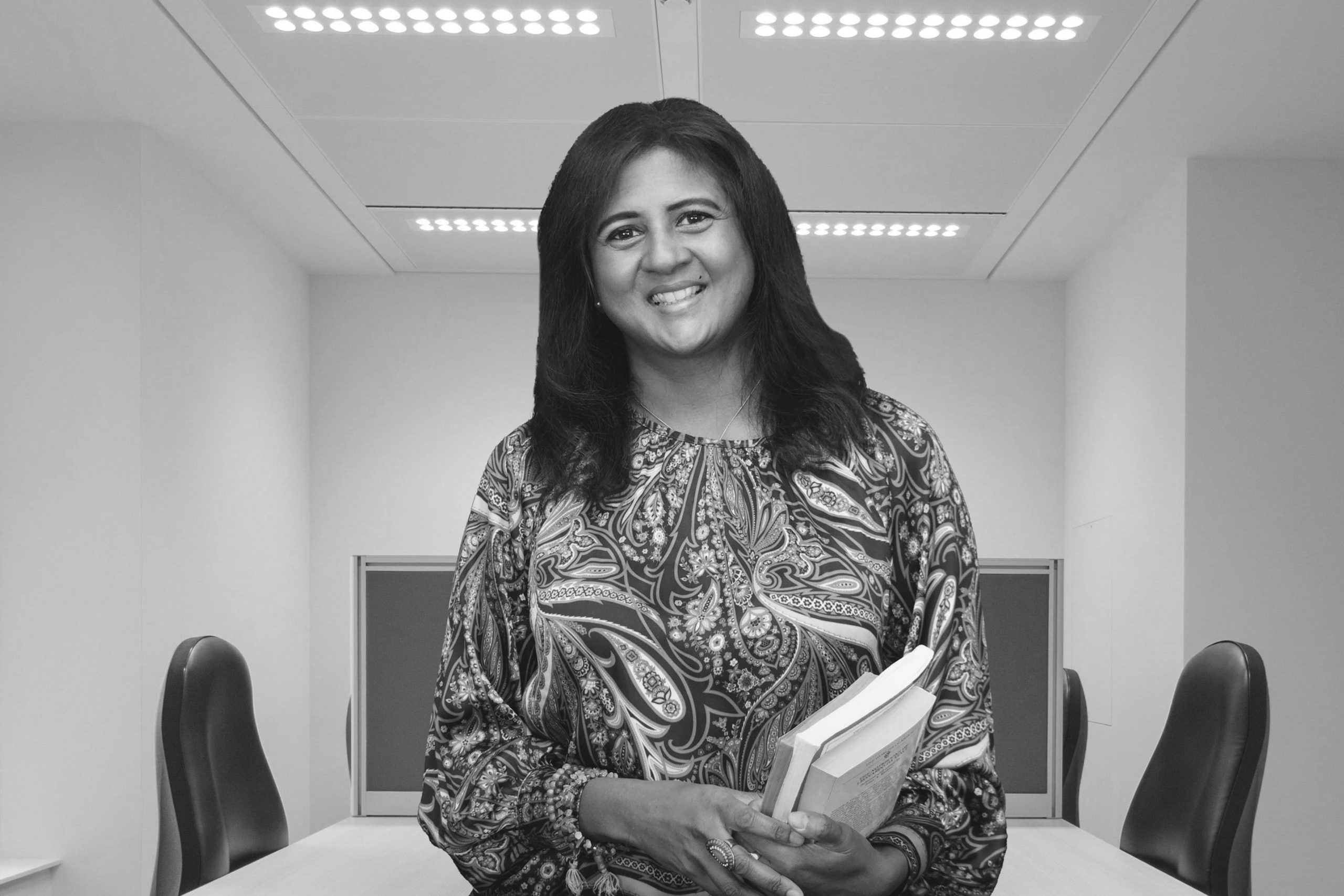 ambika standing with books in hand